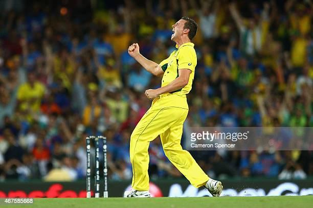 Josh Hazlewood of Australia celebrates dismissing Shikhar Dhawan of India during the 2015 Cricket World Cup Semi Final match between Australia and...