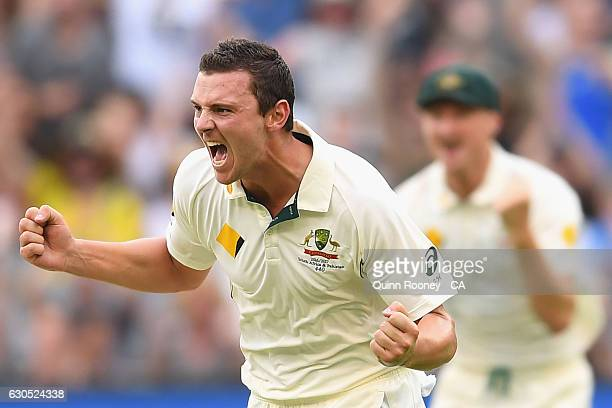 Josh Hazlewood of Australia celebrates getting the wicket of Babar Azam of Pakistan during day one of the Second Test match between Australia and...