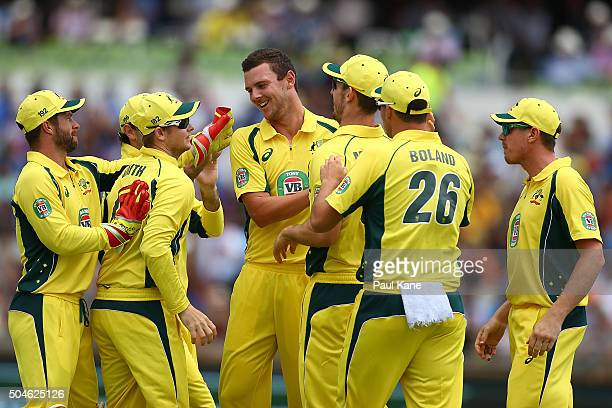 Josh Hazlewood of Australia celebrates the wicket of Shikhar Dhawan of India during the Victoria Bitter One Day International Series match between...