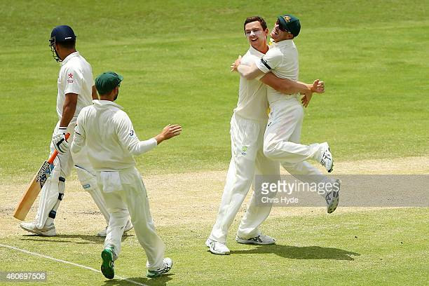 Josh Hazlewood of Australia celebrates with team mate David Warner after dismissing Mahendra Singh Dhoni of India during day four of the 2nd Test...