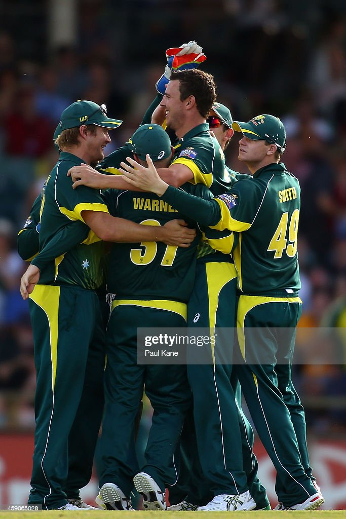 Josh Hazlewood of Australia celebrates with team mates after dismissing Farhaan Behardien of South Africa during the One Day International match between Australia and South Africa at the WACA on November 16, 2014 in Perth, Australia.