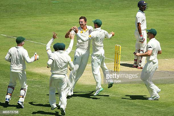 Josh Hazlewood of Australia celebrates with team mates after dismissing Cheteshwar Pujara of India during day one of the 2nd Test match between...