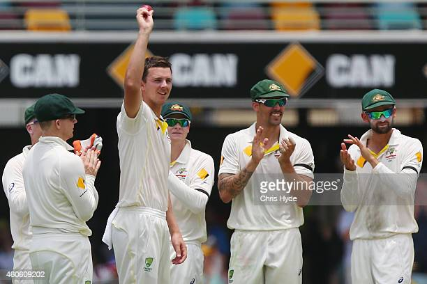 Josh Hazlewood of Australia celebrates with team mates after taking his 5th wicket after dismissing Mahendra Singh Dhoni of India and during day two...