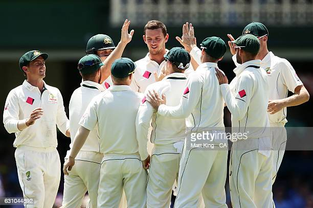 Josh Hazlewood of Australia celebrates with team mates after taking the wicket of Yasir Shah of Pakistan during day four of the Third Test match...