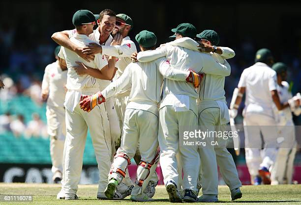 Josh Hazlewood of Australia celebrates with team mates after taking the wicket of Imran Khan of Pakistan during day five of the Third Test match...