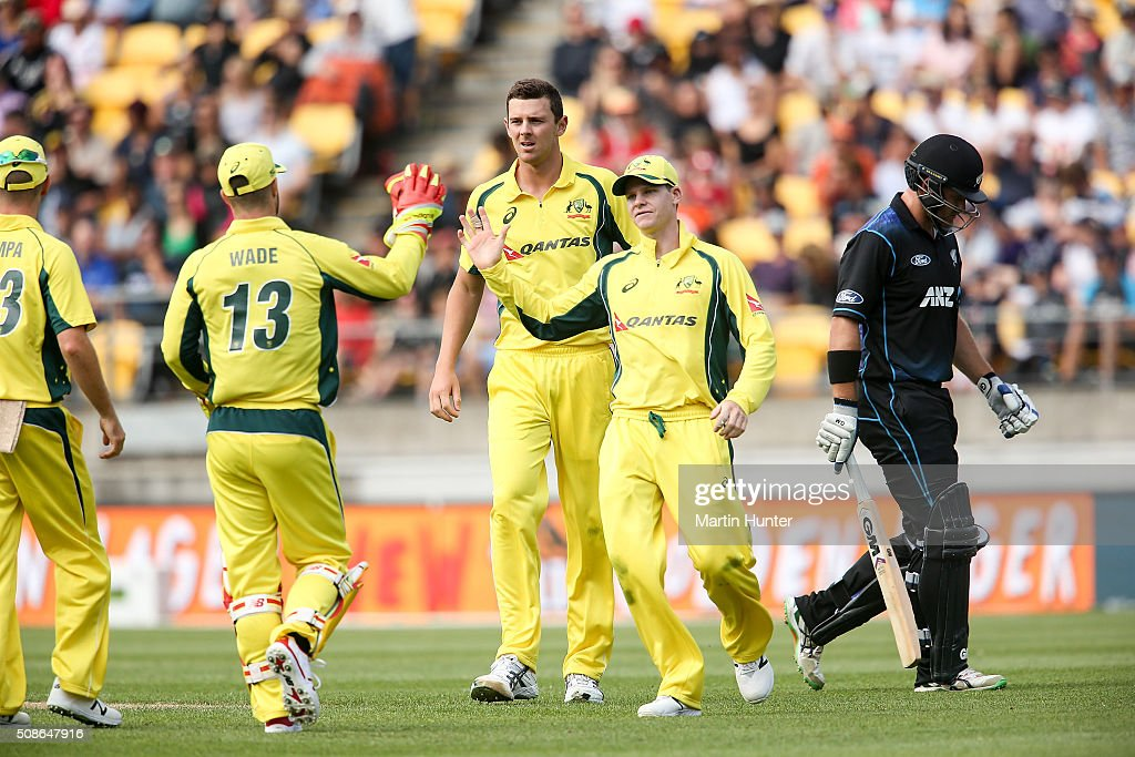 <a gi-track='captionPersonalityLinkClicked' href=/galleries/search?phrase=Josh+Hazlewood&family=editorial&specificpeople=4884811 ng-click='$event.stopPropagation()'>Josh Hazlewood</a> (C) of Australia celebrates with team mates the wicket of Corey Anderson of New Zealand during game two of the one day international series between New Zealand and Australia at Westpac Stadium on February 6, 2016 in Wellington, New Zealand.