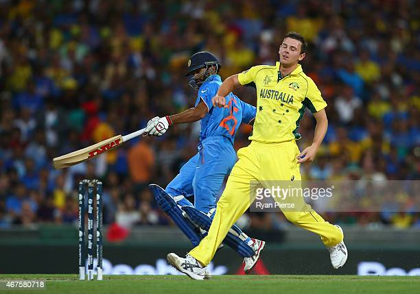Josh Hazlewood of Australia collides with Shikhar Dhawan of India during the 2015 Cricket World Cup Semi Final match between Australia and India at...