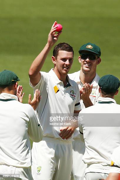 Josh Hazlewood of Australia holds up the ball after taking 5 wickets during day three of the Third Test match between Australia and New Zealand at...