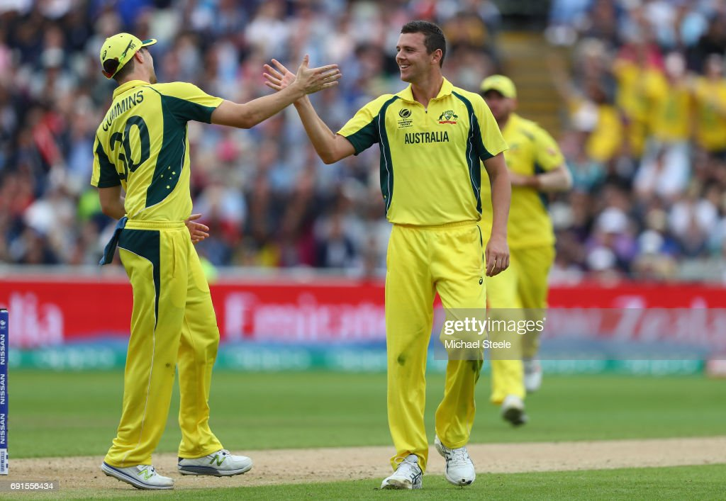 Josh Hazlewood (L) of Australia is congratulated by Pat Cummins (L) after capturing his fifth wicket during the ICC Champions Trophy match between Australia and New Zealand at Edgbaston on June 2, 2017 in Birmingham, England.