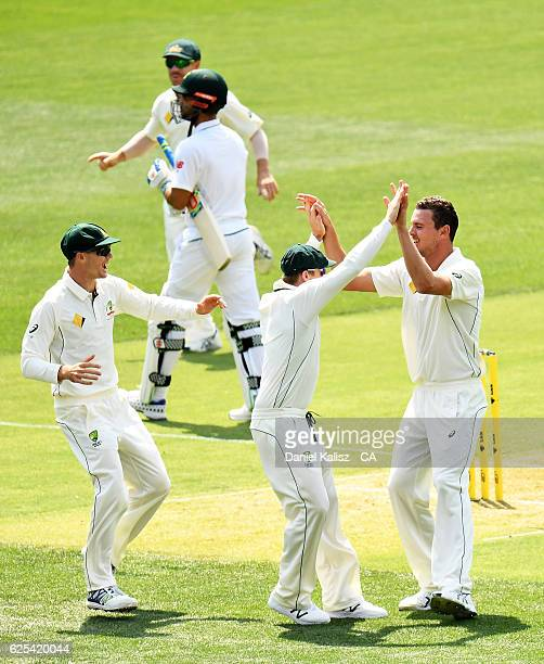 Josh Hazlewood of Australia is congratulated by Steven Smith of Australia after taking the wicket of JeanPaul Duminy of South Africa who is caught by...