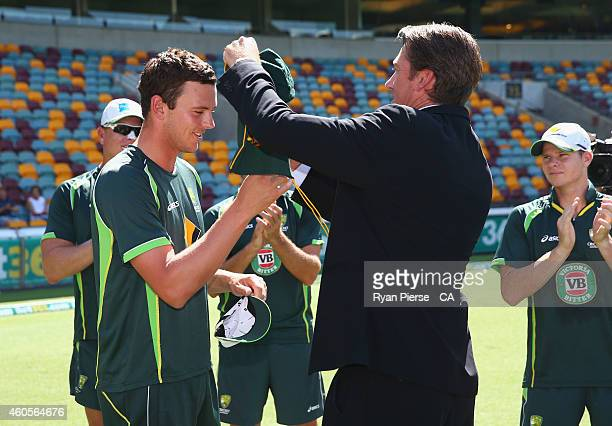 Josh Hazlewood of Australia is presented his Baggy Green Cap by for Test Cricketer Glenn McGrath during day one of the 2nd Test match between...
