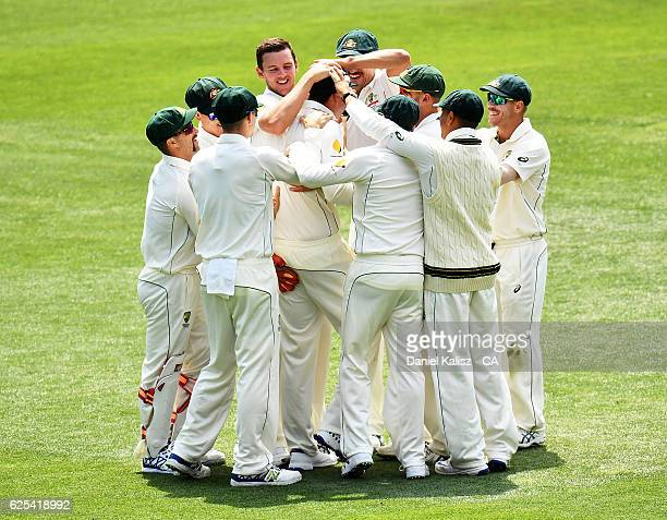 Josh Hazlewood of Australia reacts after taking the wicket of Hashim Amla of South Africa who is caught out by Matt Renshaw of Australia during day...