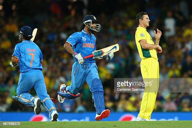 Josh Hazlewood of Australia watches his delivery get hit for four runs during the 2015 Cricket World Cup Semi Final match between Australia and India...