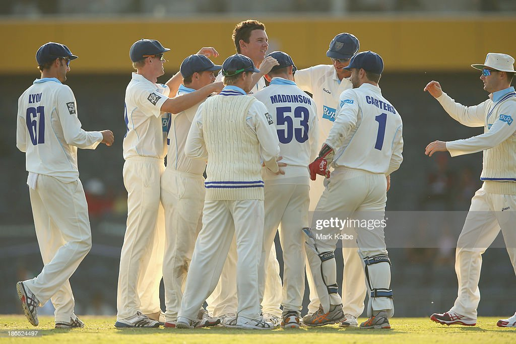 Josh Hazlewood of the Blues celebrates with his team after taking the wcket of Ed Cowan of the Tigers during day three of the Sheffield Shield match between the New South Wales Blues and the Tasmania Tigers at Blacktown International Sportspark on November 1, 2013 in Sydney, Australia.
