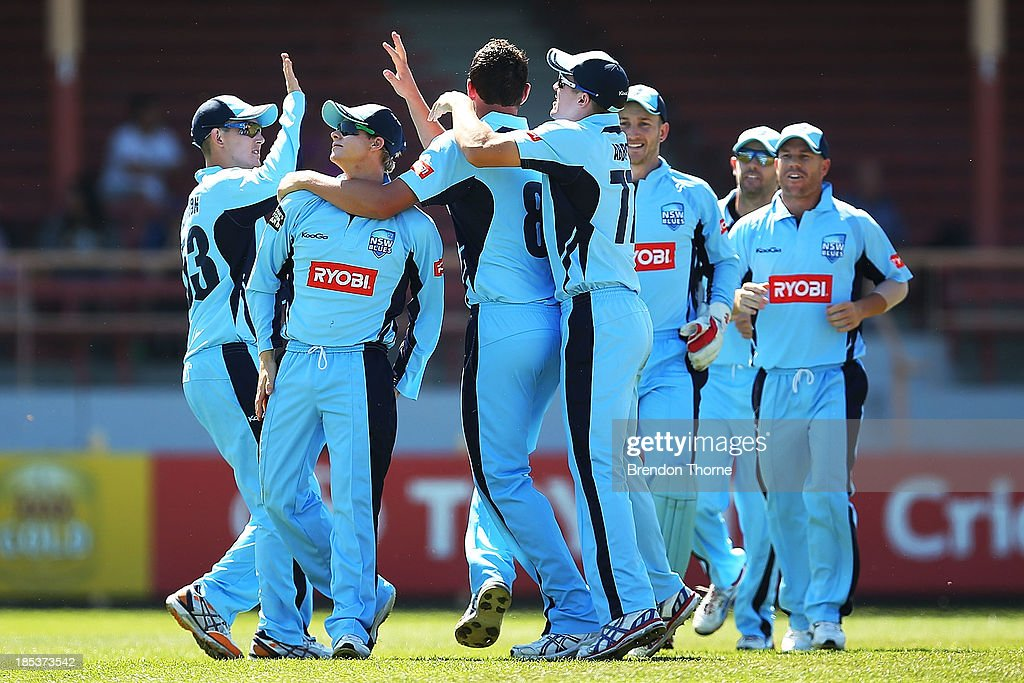 Josh Hazlewood of the Blues celebrates with team mates after claiming the wicket of Rob Quiney of the Bushrangers during the Ryobi Cup match between the New South Wales Blues and the Victorian Bushrangers at North Sydney Oval on October 20, 2013 in Sydney, Australia.