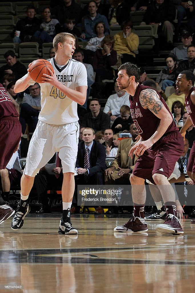 <a gi-track='captionPersonalityLinkClicked' href=/galleries/search?phrase=Josh+Henderson+-+Basketball+Player&family=editorial&specificpeople=15212566 ng-click='$event.stopPropagation()'>Josh Henderson</a> #40 of the Vanderbilt Commodores plays against Andrew Young #00 of the Texas A&M Aggies at Memorial Gym on February 16, 2013 in Nashville, Tennessee.
