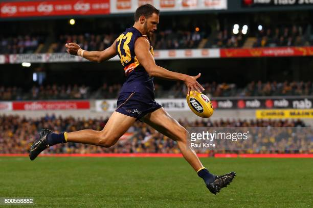 Josh Hill of the Eagles kicks on goal during the round 14 AFL match between the West Coast Eagles and the Melbourne Demons at Domain Stadium on June...