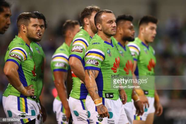 Josh Hodgson of the Raiders and team mates look dejected after a Sharks try during the round two NRL match between the Canberra Raiders and the...