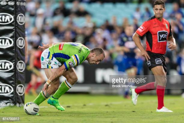 Josh Hodgson of the Raiders grounds the ball for a try during the round nine NRL match between the Canterbury Bulldogs and the Canberra Raiders at...