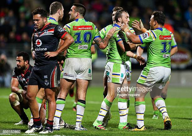 Josh Hodgson of the Raiders is congratulated on his try by Josh Papalii during the round 11 NRL match between the New Zealand Warriors and the...