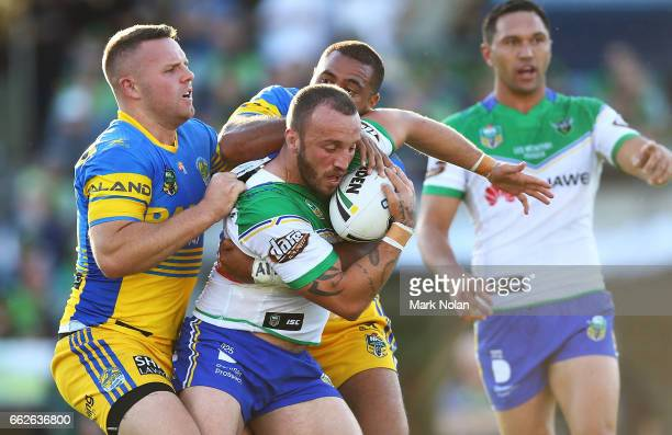 Josh Hodgson of the Raiders is tackled during the round five NRL match between the Canberra Raiders and the Parramatta Eels at GIO Stadium on April 1...