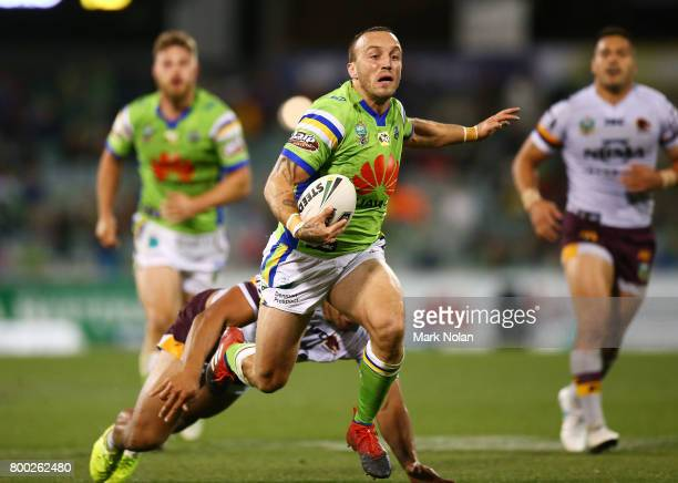 Josh Hodgson of the Raiders makes a line break during the round 16 NRL match between the Canberra Raiders and the Brisbane Broncos at GIO Stadium on...