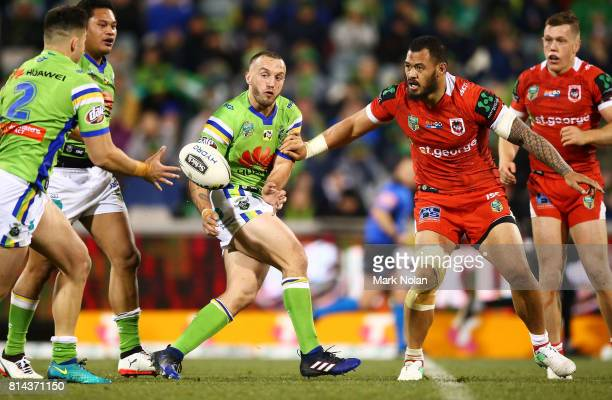 Josh Hodgson of the Raiders offloads during the round 19 NRL match between the Canberra Raiders and the St George Illawarra Dragons at GIO Stadium on...