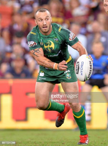 Josh Hodgson of the Raiders passes the ball during the round four NRL match between the Brisbane Broncos and the Canberra Raiders at Suncorp Stadium...