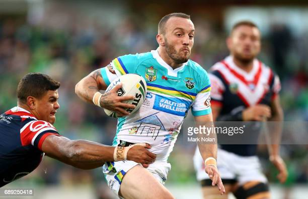 Josh Hodgson of the Raiders runs the ball during the round 12 NRL match between the Canberra Raiders and the Sydney Roostrers at GIO Stadium on May...