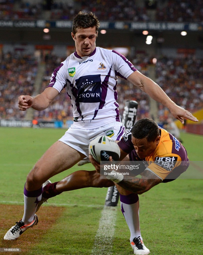 Josh Hoffman of the Broncos attempts to ground the ball during the round four NRL match between the Brisbane Broncos and the Melbourne Storm at Suncorp Stadium on March 29, 2013 in Brisbane, Australia.