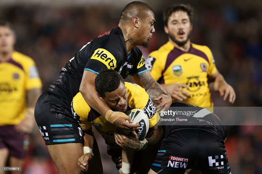 Josh Hoffman of the Broncos is tackled by Sika Manu and Luke Walsh of the Panthers during the round 24 NRL match between the Penrith Panthers and the Brisbane Broncos at Centrebet Stadium on August 23, 2013 in Sydney, Australia.