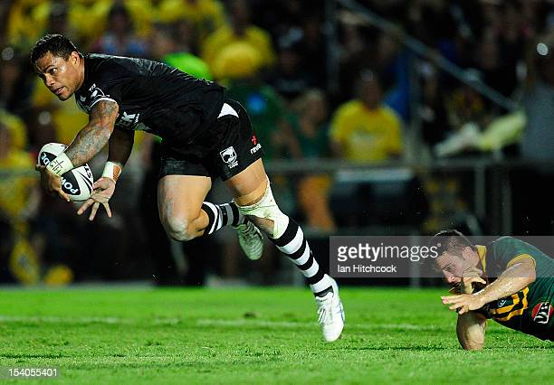 Josh Hoffman of the Kiwis skips out of the tackle of Cooper Cronk of the Kangaroos during the International Test match between the Australian...