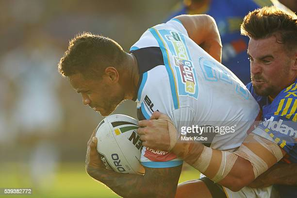 Josh Hoffman of the Titans is tackled by Clint Gutherson of the Eels during the round 14 NRL match between the Parramatta Eels and the Gold Coast...