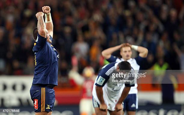 Josh Hohneck of the Highlanders celebrates while a dejected Charlie Faumuina and Ihaia West of the Blues look on during the round 10 Super Rugby...
