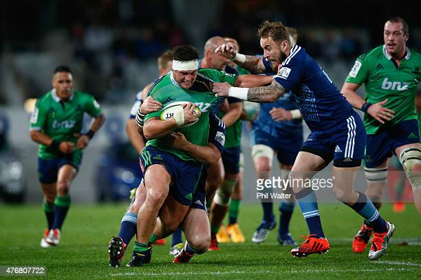 Josh Hohneck of the Highlanders is tackled bu Jimmy Cowan of the Blues during the round 18 Super Rugby match between the Blues and the Highlanders at...