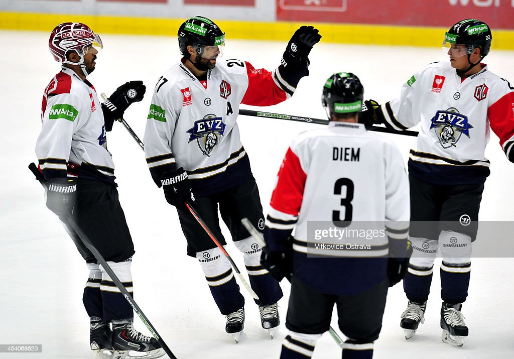 Josh Holden of EV Zug celebrates with his teammates after scoring a goal during the Champions Hockey League group stage game between Vitkovice Ostrave and EV Zug on August 23, 2014 in Ostrava, Czech Republic.