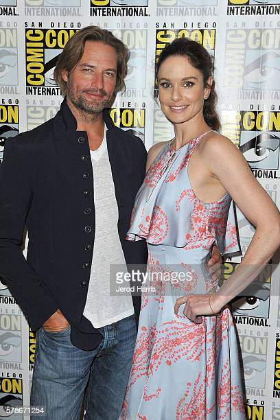 Josh Holloway and Sarah Wayne Callies attend the press line for 'Colony' at Comic Con on July 21 2016 in San Diego California