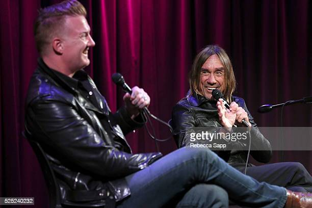 Josh Homme and Iggy Pop speak onstage at A Conversation With Iggy Pop And Josh Homme at The GRAMMY Museum on April 27 2016 in Los Angeles California