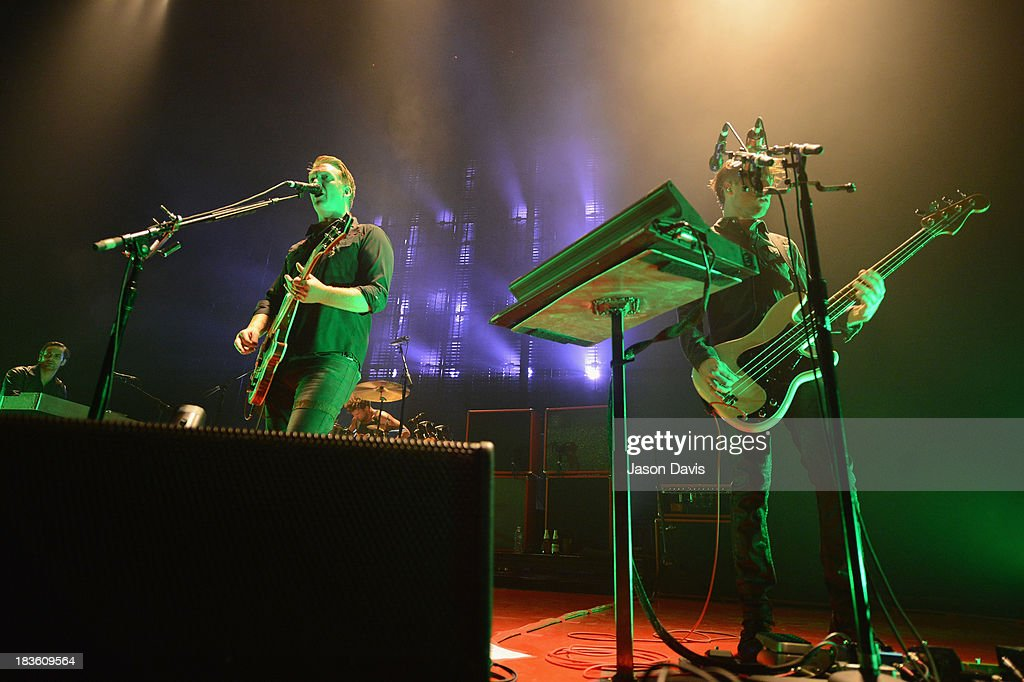<a gi-track='captionPersonalityLinkClicked' href=/galleries/search?phrase=Josh+Homme&family=editorial&specificpeople=211243 ng-click='$event.stopPropagation()'>Josh Homme</a> and Michael Shuman of Queens of the Stone Age perform at Nashville Municipal Auditorium on October 7, 2013 in Nashville, Tennessee.