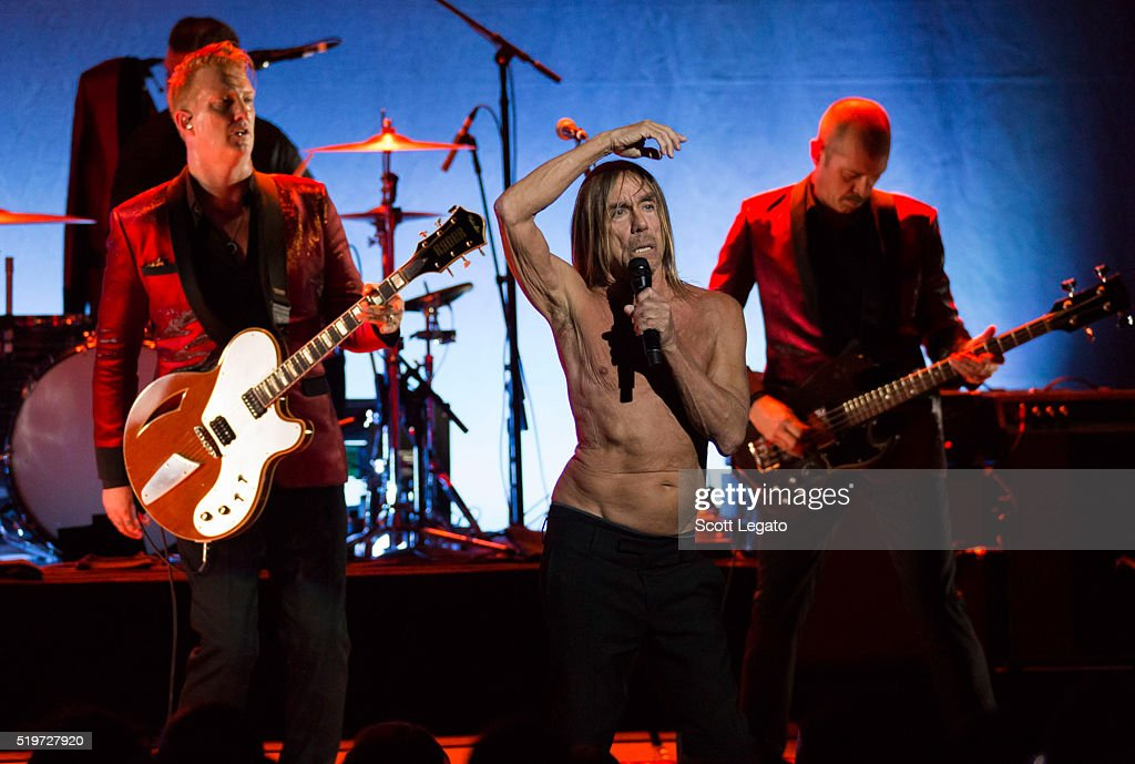 Josh Homme (L) Iggy Pop perform in support of the Post Pop Depression Tour at Fox Theatre on April 7, 2016 in Detroit, Michigan.