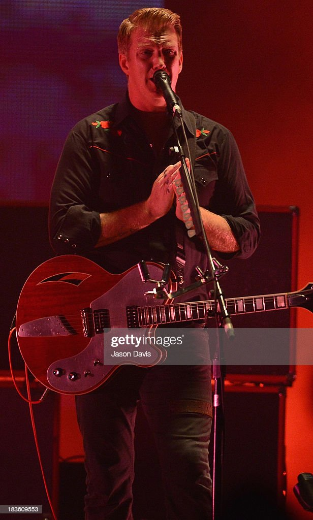 <a gi-track='captionPersonalityLinkClicked' href=/galleries/search?phrase=Josh+Homme&family=editorial&specificpeople=211243 ng-click='$event.stopPropagation()'>Josh Homme</a>, lead singer of Queens of the Stone Age, performs at Nashville Municipal Auditorium on October 7, 2013 in Nashville, Tennessee.