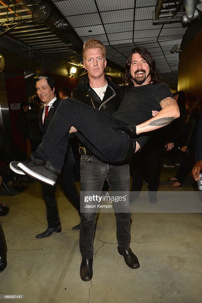 Josh Homme (L) of Queens of the Stone Age and Dave Grohl of Foo Fighters attends the 56th GRAMMY Awards at Staples Center on January 26, 2014 in Los Angeles, California.
