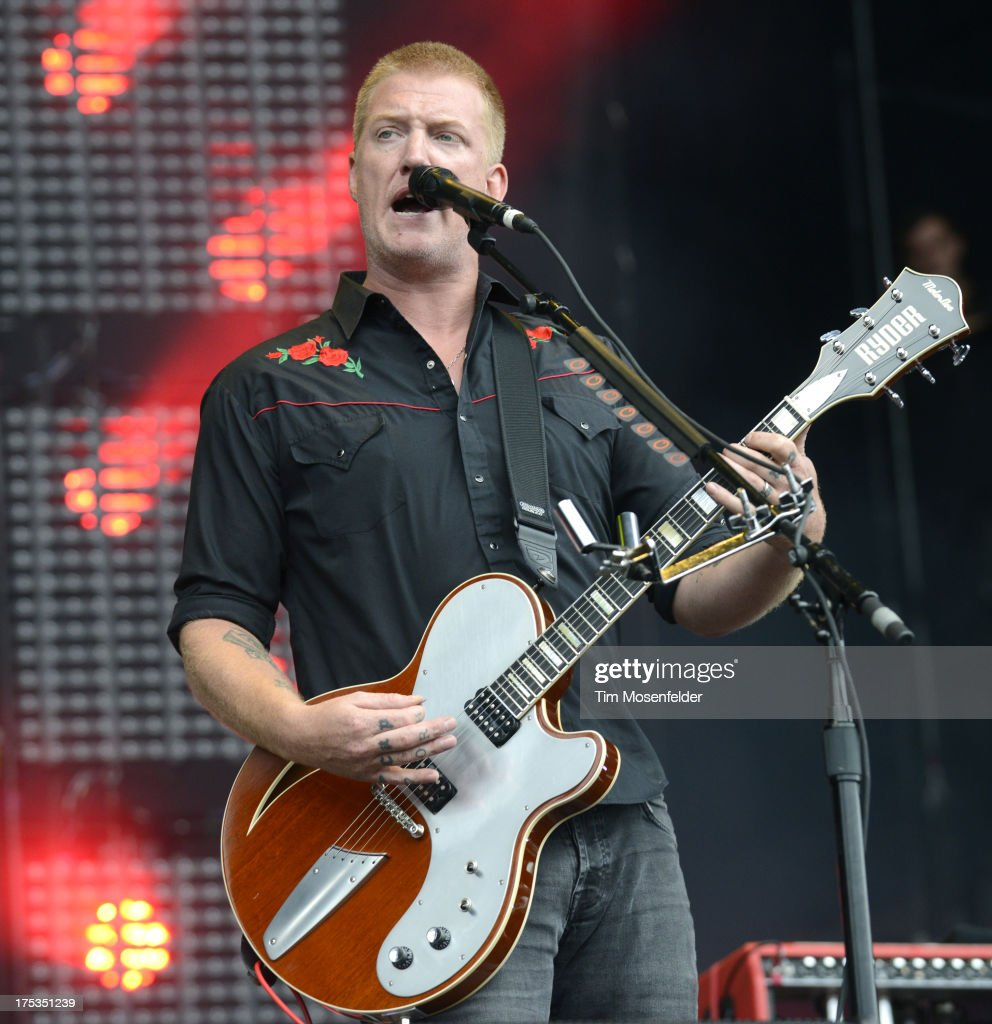 <a gi-track='captionPersonalityLinkClicked' href=/galleries/search?phrase=Josh+Homme&family=editorial&specificpeople=211243 ng-click='$event.stopPropagation()'>Josh Homme</a> of Queens of the Stone Age performs as part of Lollapalooza 2013 at Grant Park on August 2, 2013 in Chicago, Illinois.