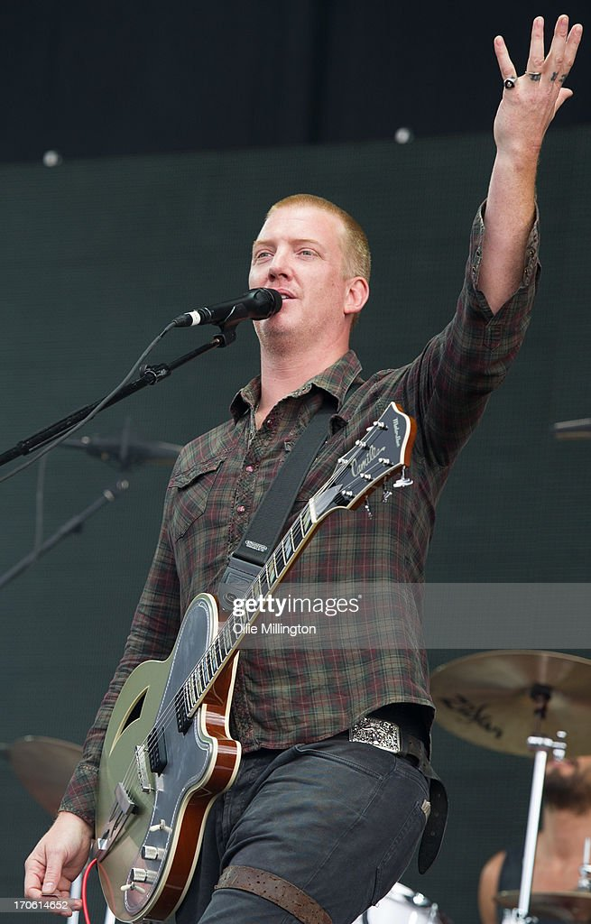 <a gi-track='captionPersonalityLinkClicked' href=/galleries/search?phrase=Josh+Homme&family=editorial&specificpeople=211243 ng-click='$event.stopPropagation()'>Josh Homme</a> of Queens of The Stone Age performs at Day 2 of The Download Festival at Donnington Park on June 15, 2013 in Donnington, England.