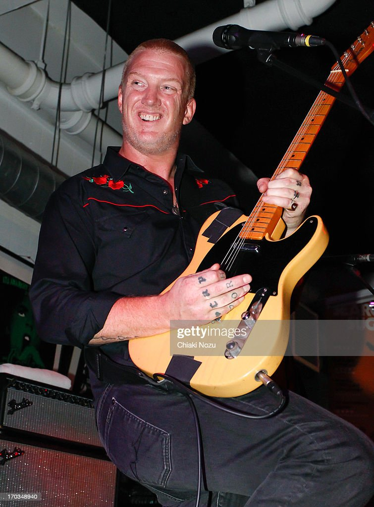 <a gi-track='captionPersonalityLinkClicked' href=/galleries/search?phrase=Josh+Homme&family=editorial&specificpeople=211243 ng-click='$event.stopPropagation()'>Josh Homme</a> of Queens of the Stone Age performs at Rough Trade East on June 11, 2013 in London, England.