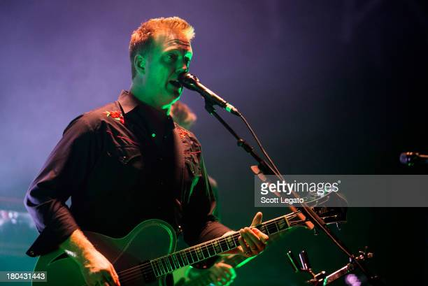 Josh Homme of Queens of the Stone Age performs in concert at The Fillmore on September 12 2013 in Detroit Michigan