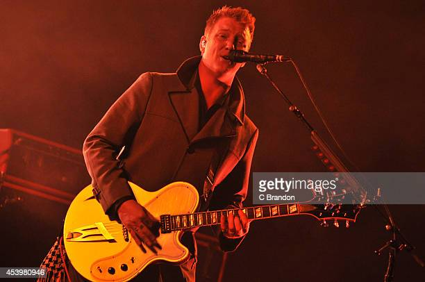 Josh Homme of Queens of the Stone Age performs on stage at the Reading Festival at Richfield Avenue on August 22 2014 in Reading United Kingdom