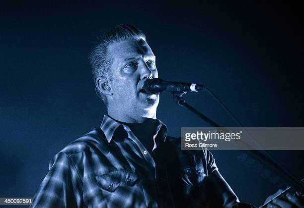 Josh Homme of Queens of the Stone Age performs on stage at The SSE Hydro on November 16 2013 in Glasgow United Kingdom