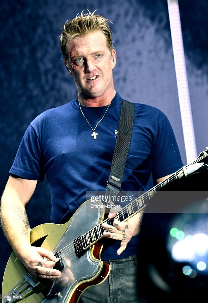 Josh Homme of Queens of the Stone Age performs with a bloody face onstage during KROQ Almost Acoustic Christmas 2017 at The Forum on December 9, 2017 in Inglewood, California.