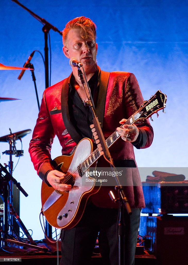 Josh Homme performs with Iggy Pop in support of the Post Pop Depression Tour at Fox Theatre on April 7 2016 in Detroit Michigan